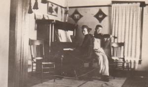 This is the only photo I have inside the Benton home and the only photo of Ruth at the piano.  Merl is playing violin.