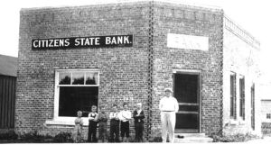 I found this photo of the bank in Central City on the web.  Don't know who the people are.